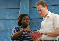 Chris Dunford and a Microfinance client in Ghana